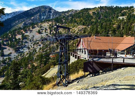 September 26, 2016 in Mt Baldy, CA:  Chairlift which disembarks at the Mt Baldy Notch Ski Lodge where people can dine and relax in the summer with views of the mountains and where people relax while skiing during winter taken in Mt Baldy, CA