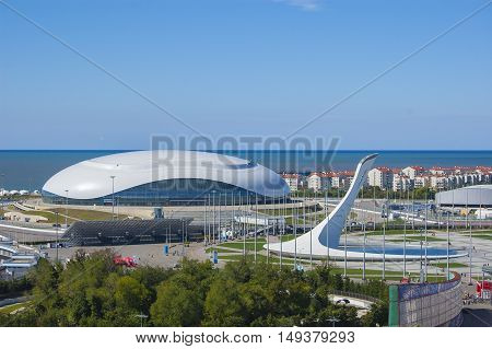 Sochi, Russia - September 24: Bolshoy Ice Dome and Fire of Olympic Games at the Park on September 24:, 2016