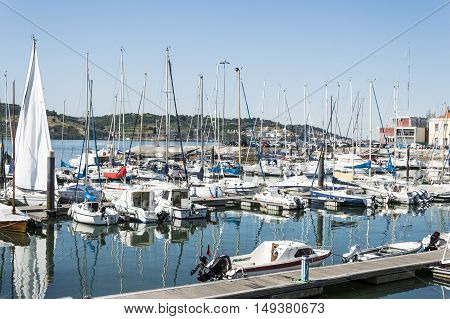 Lisbon Portugal - July 17 2016: Boats and yachts parked at port of Belem during a hot summer day
