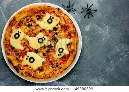 Halloween spooky ghost pizza - easy healthy and delicious fun food party treats for kids top view blank space for text