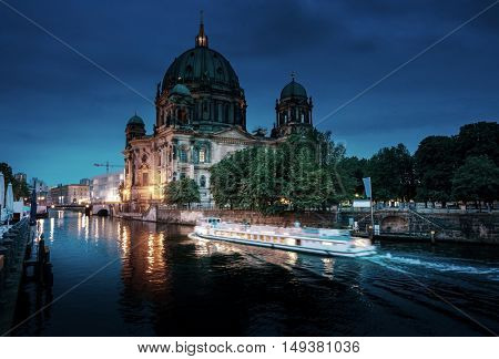 Berlin Cathedral with excursion boat on Spree river, Berlin, Germany