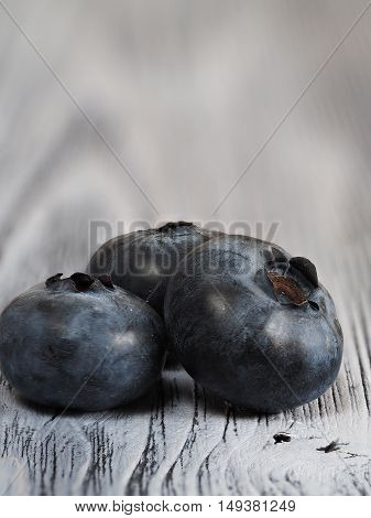 Fresh blueberries fruits on the wooden backgroun