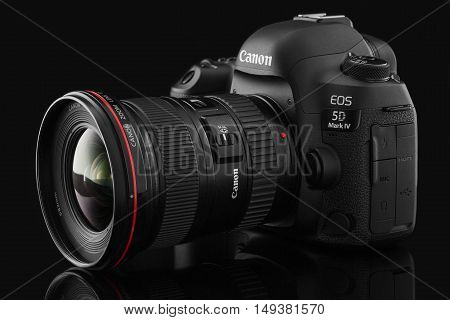 Varna Bulgaria - September 24 2016: Canon 5D Mark IV camera with Canon EF 16-35mm f/2.8L II USM lens on a black background. Canon is the world largest SLR camera manufacturer.