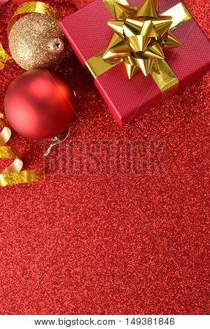 Xmas Decoration With Gift And Balls On Bright Red Table