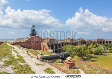 The Garden Key Lighthouse and cannon atop Fort Jefferson in the Dry Tortugas National Park, Florida, United States.
