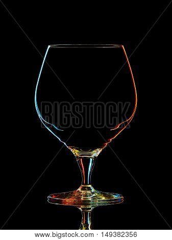 Silhouette of colorful whiskey glass with clipping path on black background.