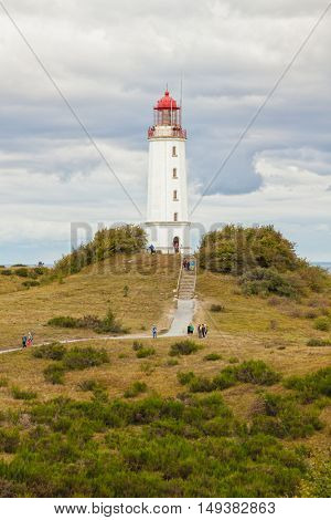 Hiddensee, Germany - September 19, 2016: Tourists visiting Dornbusch lighthouse at the northern tip of Hiddensee island.