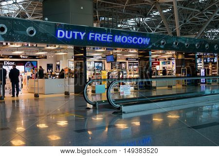 Moscow, Russia - September 19, 2016: People visit duty free shop in Vnukovo airport at evening