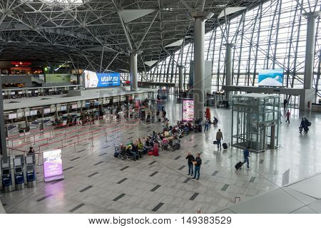 Moscow, Russia - September 19, 2016: People visit departure hall in international Vnukovo airport at day time