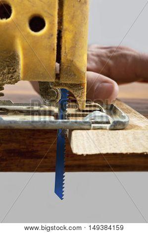Carpenter using a electric saw. Concept of a hobby handmade.