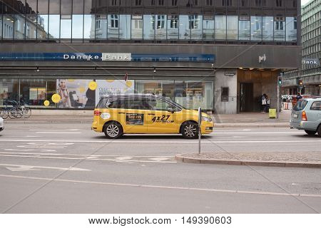 COPENHAGEN, DENMARK - JULY 14, 2016: A yellow city taxi in Copenhagen, Denmark