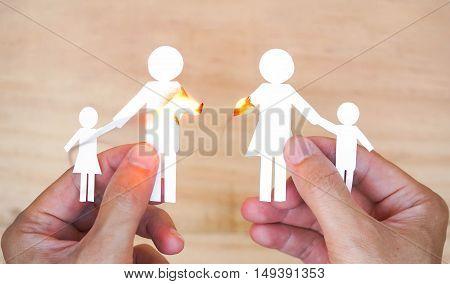 Burnt paper cut of family / Broken family concept / divorce