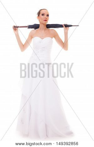 Wedding day at a raining day. Full length romantic bride with blue closed umbrella isolated on white background