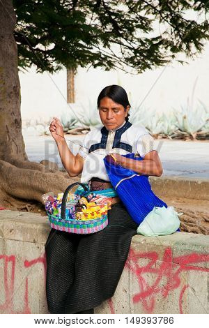 OAXACA MEXICO- DECEMBER 7, 2015: Woman selling sweets and sew on the street in Oaxaca on Dec 7, 2015, Mexico.