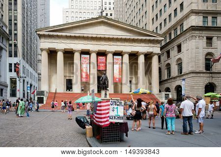 NEW YORK,USA - AUGUST 21,2016: Wall street and the Federal Hall in New York's Financial District