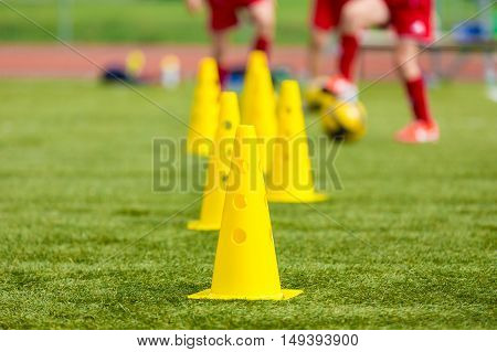 Soccer football equipment; training soccer field. Young footballers daily training