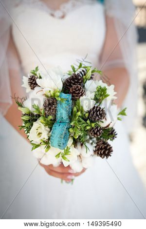 nice turquoise wedding bouquet in bride's hand
