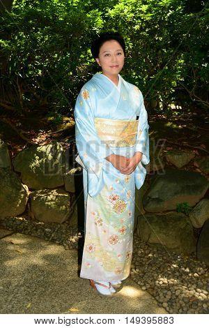 Beautiful Japanese woman wearing a light blue Kimono