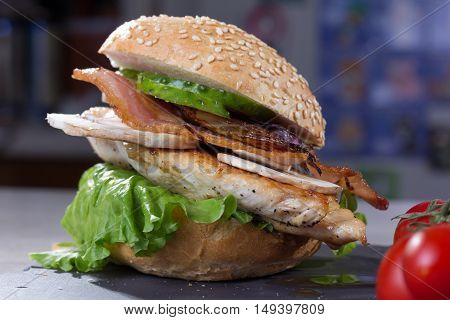 Burger With Grilled Chicken Breast, Bacon, Lettuce And Vegetables