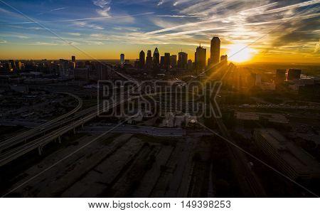 Dallas Texas Sunrise over Horizon Starburst in front of the Massive Downtown Skyline Cityscape Urban Sprawl