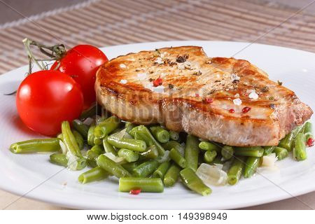 Two Pieces Of Fried Pork Loin With Vegetables On A White Background. Not Isolated