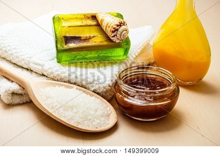 Beauty treatment therapy and skin care. Closeup spa products some bath accessories on wooden table.