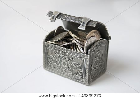 Ajar decorative chest with Russian rubles on a white background