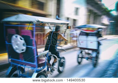 HAVANA, CUBA - 5 OCT, 2008. Bicitaxis rushing in Havana street, commonly used as private taxi for short distances ride