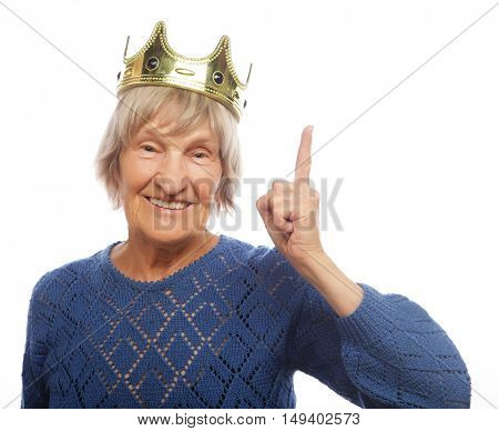 Senior woman wearing crown doing funky action