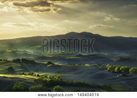 Tuscany rolling hills on sunset. Rural landscape. Green fields and farmlands. Volterra Italy Europe