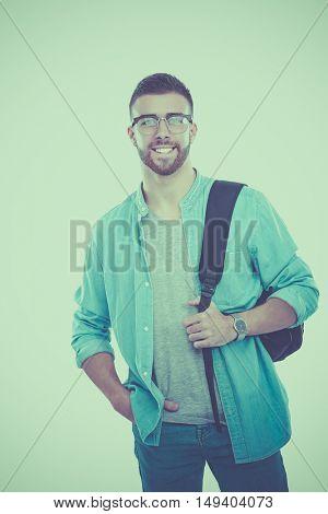 Young man standing with handbag,