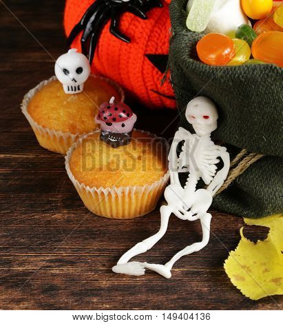 candy and sweet muffins, decorations for Halloween