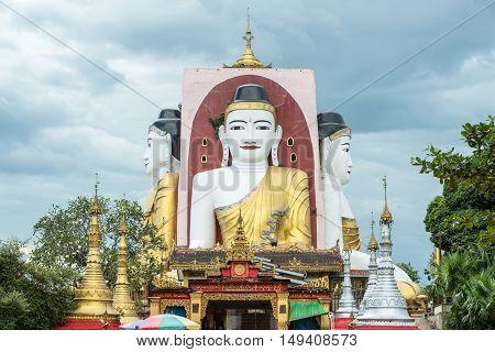 Kyaik-Pun Pagoda, Four towering images of the Buddha sitting back to back, Myanmar.