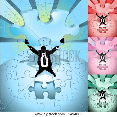 Business Man Completing Jigsaw