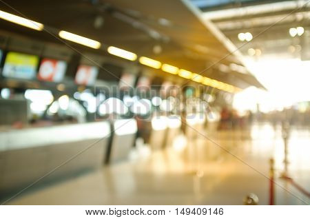 Blurred Shot of Check in Counter and Passengers in a airport departure terminal.