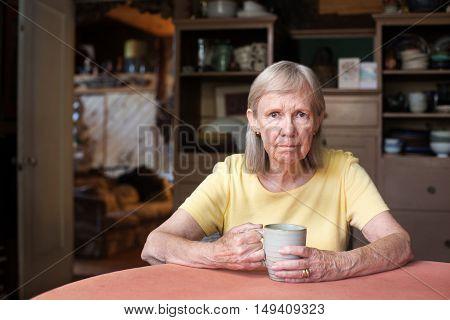 Senior Woman Sitting At Table