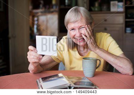 Laughing Woman Looking At Photo