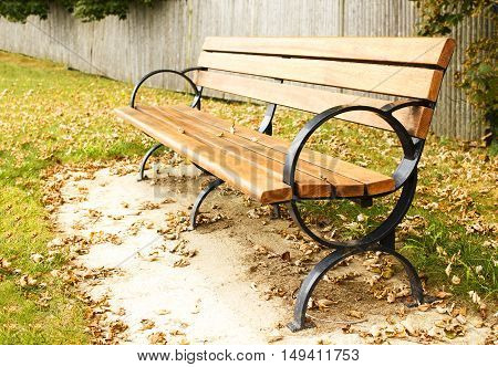 bench in the autumn park. empty bench in the park is dotted with dry autumn leaves