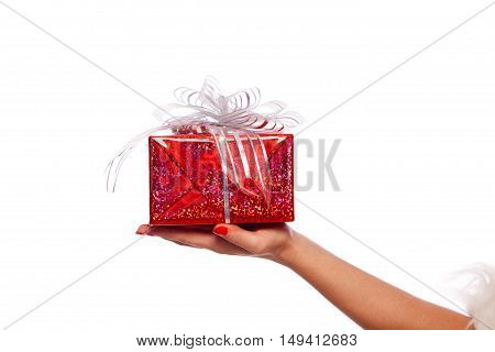 Christmas. Photo of Santa Claus gloved hand with red gift box, on a White background, isolated.