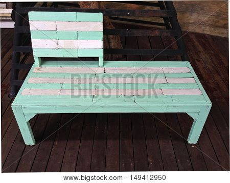 Close up vintage white and green wooden bench