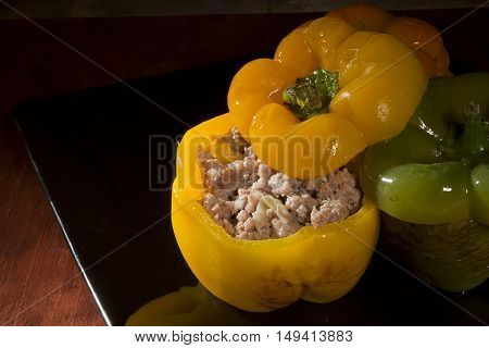 Homemade Stuffed Sweet Peppers on black background