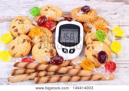 Glucometer And Colorful Candies With Cookies, Diabetes, Reduction Eating Sweets