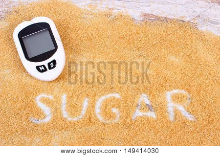 Glucometer And Granulated Brown Cane Sugar, Concept Of Diabetes