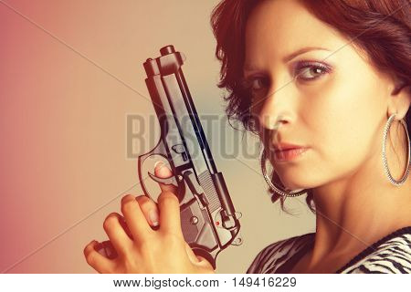 Sexy woman holding hand gun