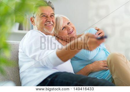 Senior couple with remote control