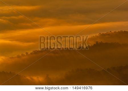 Layer of mountains in the mist at sunrise time Sri Nan National Park Nan Province Thailand