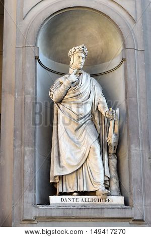 FLORENCE, ITALY - January 20, 2016: Dante Alighieri ( italian florentine poet ) statue by Emilio Demi on facade of Uffizi Gallery, Florence, Italy