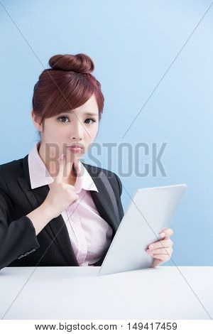 business woman use tablet upset with isolated on blue background