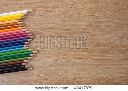 colorful pencils on a wooden table