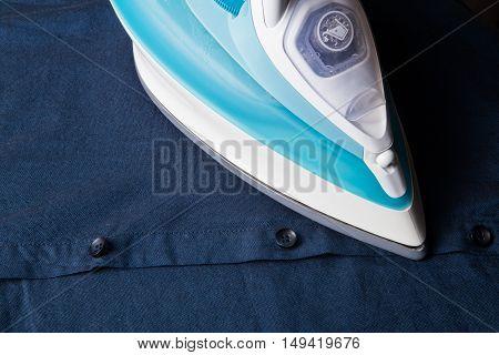 Modern Iron On Dark Blue Shirt